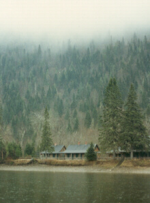 Fog shrouds a lodge on the Restigouche